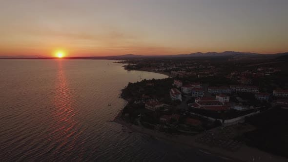 Thumbnail for Aerial Shot of Greek Resort on Sea Coast, View at Sunset