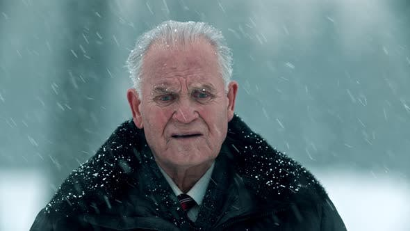 Thumbnail for Elderly Grandfather - Gray-haired Sad Grandfather Is Standing Outside in Snowfall