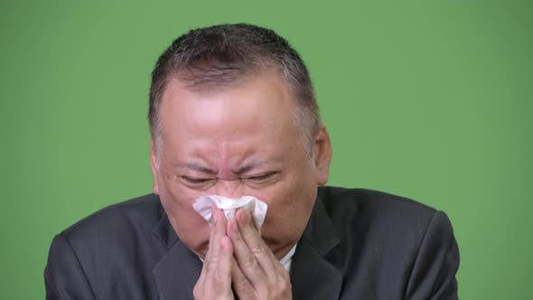 Thumbnail for Mature Japanese Businessman Feeling Sick