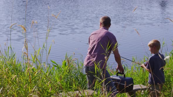 Thumbnail for Father and son fishing at lake