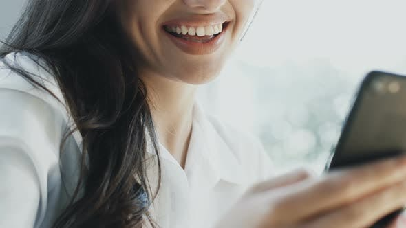 Thumbnail for Close-up of Woman Smiling with Perfect Teeth and Using Telephone