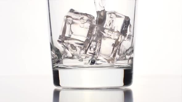Thumbnail for Water Stream Into A Clear Glass With A Ice Cubes