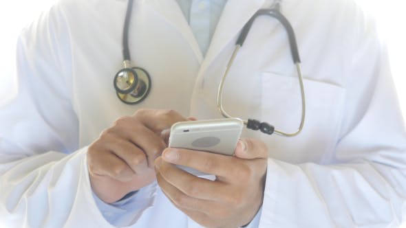 Thumbnail for Using Mobile Phone, Gesture By Doctor