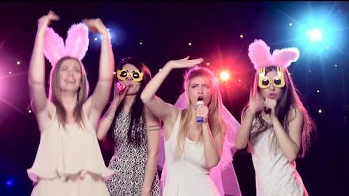 Girls Having Fun at Bachelorette Party Dancing Blowing Soap Bubbles