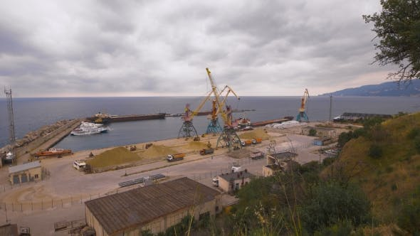 Thumbnail for Cargo Port. Crane With Bucket Makes Loading Sand Into a Truck.