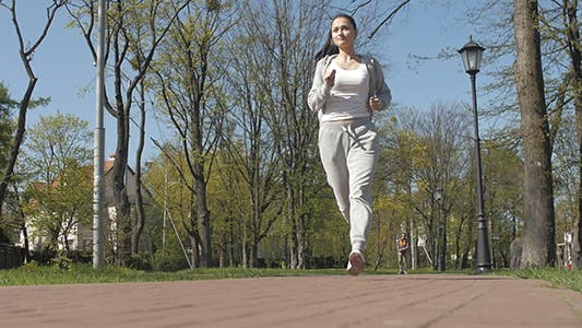 Young Female Athlete Jogging