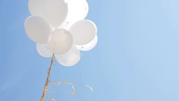 Thumbnail for Inflated White Helium Balloons In Blue Sky 1