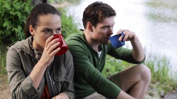 Thumbnail for Happy Couple With Cups Drinking Tea In Nature 9