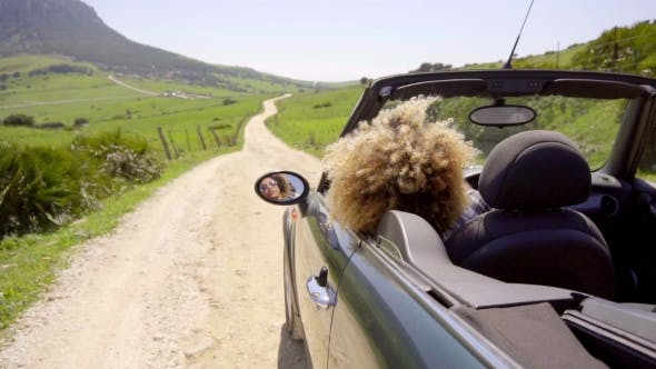 Thumbnail for Woman Drives Along An Empty Road
