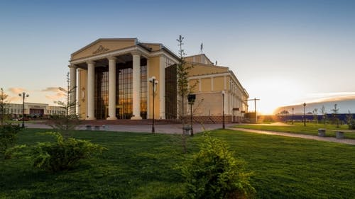 Sunset On a Background of Drama Theater Building. Kazakhstan