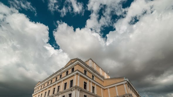 Thumbnail for Large White Cloud In The Blue Sky Over The Building Of The Theater. Kazakhstan