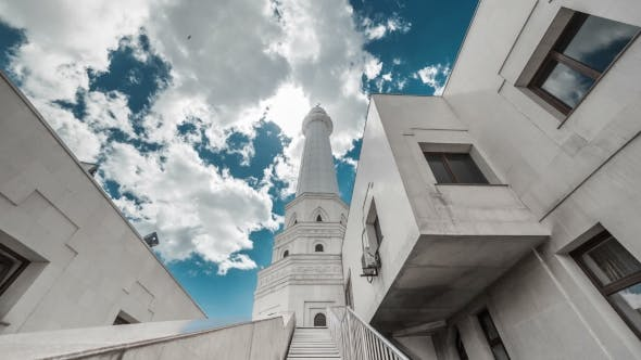 Cover Image for The Sun Breaks Through the Clouds Over a White Mosque. Kazakhstan