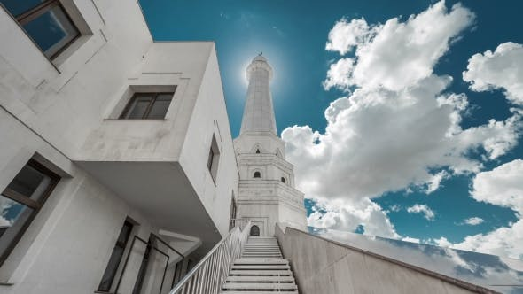 Thumbnail for White Tower of the Mosque Before the Sun on a Background of Blue Sky and Clouds. Kazakhstan