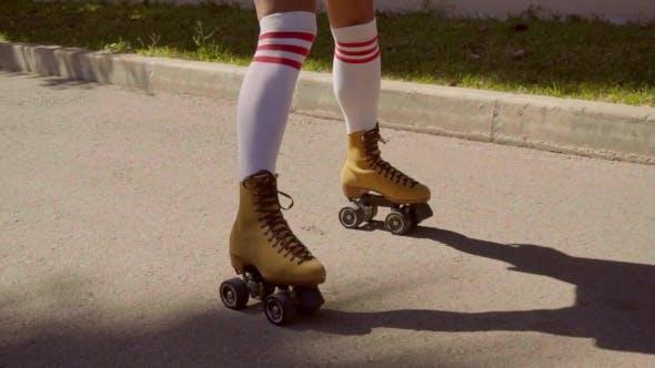 Thumbnail for Female Legs On Vintage Roller Skater On The Road.