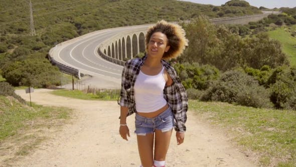Thumbnail for Black Woman Walks Along An Empty Road