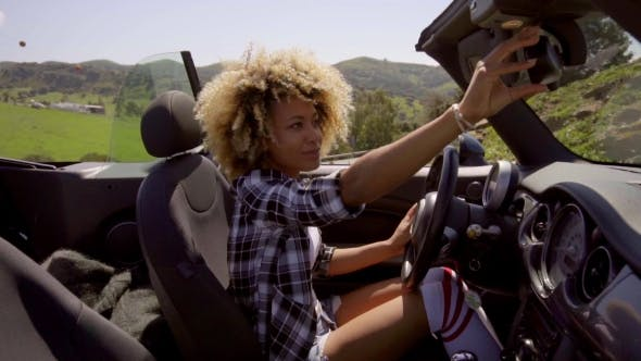 Thumbnail for Young Woman Sitting In Cabriolet.