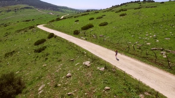 Hilly Terrain With Walking Woman.
