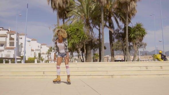 Thumbnail for Woman Riding On Vintage Roller Skates.