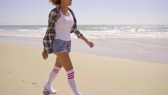 Thumbnail for Sexy Woman Walks Beach Along