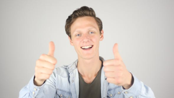 Thumbnail for Young Boy Showing Thumbs up in Excitement of Achievement