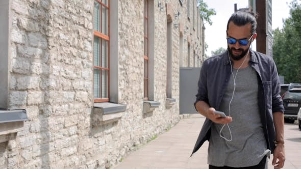Thumbnail for Happy Man With Earphones Over Walking In City 11