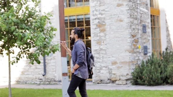 Thumbnail for Man With Backpack Calling On Smartphone In City 37