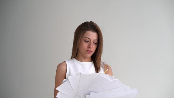 Thumbnail for Tired Businesswoman Throws Paper Document Pages