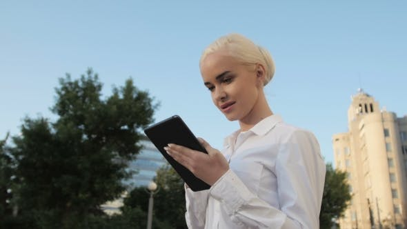 Thumbnail for Portrait Of Young Beautiful Business Woman Using Tablet PC Outdoors