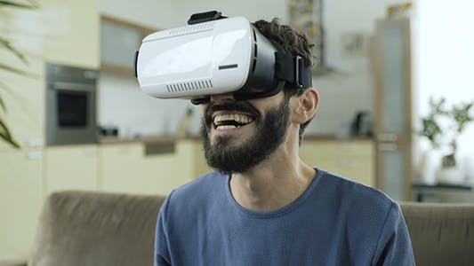 Thumbnail for Man Explores Virtual Reality World
