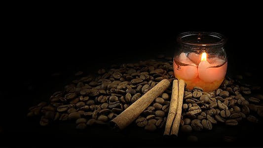 Coffee Beans with Cinnamon Sticks and Aromatic Candle