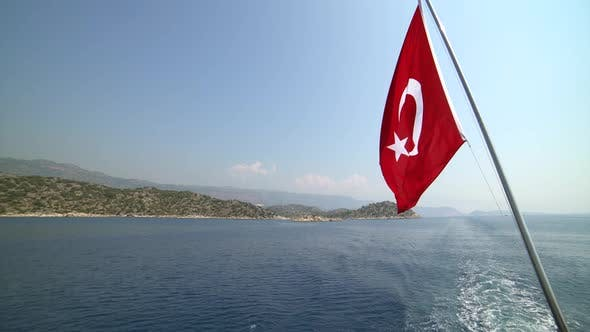 Turkish Flag Waving Behind the Boat, Symbolizing the Sea Holiday and Tourism in Turkey