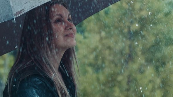 Thumbnail for Blonde Woman Under Umbrella Toching Drops Of Rain