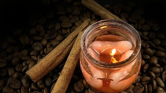 Thumbnail for Coffee Beans with Cinnamon Sticks and Aromatic Candle on Black