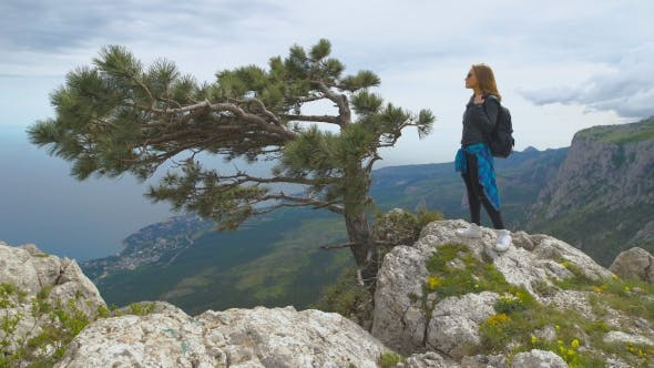Thumbnail for Hiker With Backpack Standing On Top Of The Mountain And Enjoying Valley View.