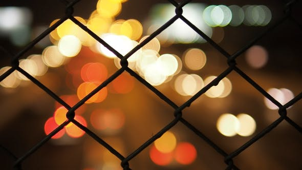 Thumbnail for Traffic Lights Through Fence