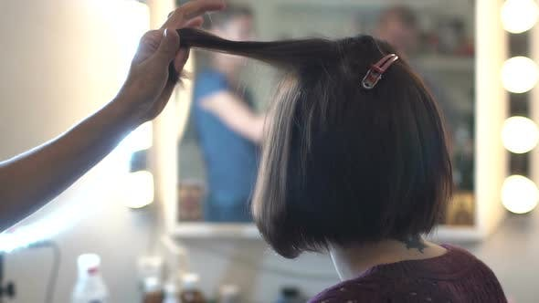 Thumbnail for Woman Make-Up Artist Doing  Hair Styling To Beautiful Young Woman