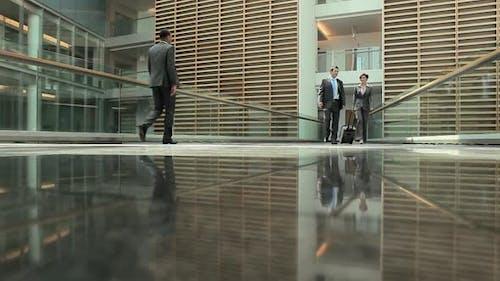 Businesspeople on walkway in office building
