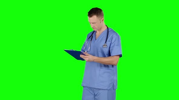 Thumbnail for Doctor Takes Notes. Green Screen