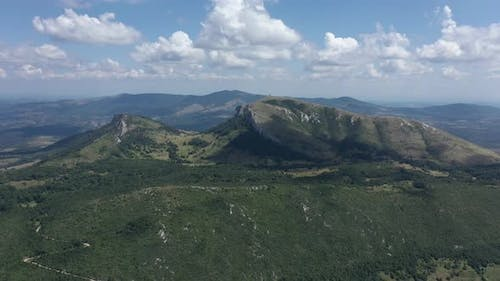 High above mountain Stol with ranges of Deli Jovan in background 4K drone footage