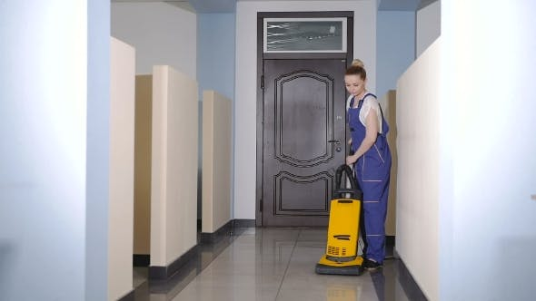 Thumbnail for Woman Vacuuming The Floor In The Office.