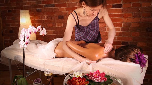 Woman Getting Massage in Beauty Spa Center