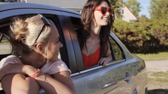 Thumbnail for Happy Teenage Girls Or Women In Car At Seaside 28