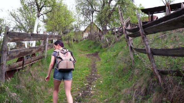 Thumbnail for Tourist Girl Walking On a Hill Near a Village