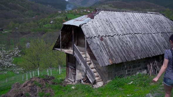 Thumbnail for Woman Sitting On Balcony Of a Wooden House, Mountain Hills