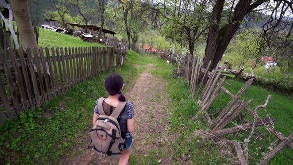 Thumbnail for Asian Girl Walking On a Hill Across a Village
