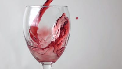 Red Wine Flowing Into Wine Glass