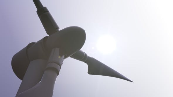 Thumbnail for Single Rotating Wind Turbine Against Sunny Sky And Blazing Sun   Shot