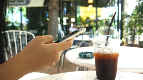 Thumbnail for Using Smartphone In coffee Shop