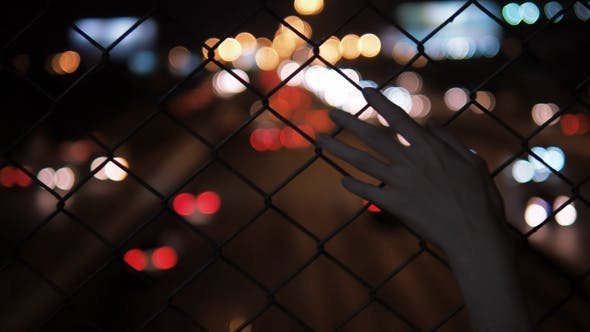 Thumbnail for Hand Touching With Fence
