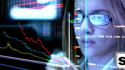 Business Woman Looking Economic Charts